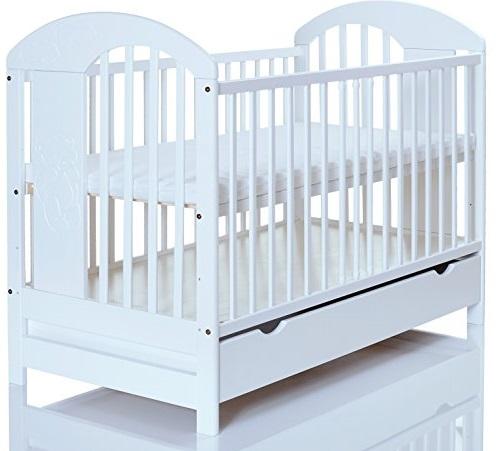lit bébé blanc 120x60 massif en pin lasse blanc marron avec un grand tiroir